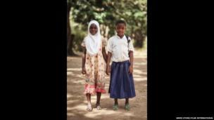 Tanzanian schoolgirl Sylvia and her Muslim friend Radhia