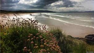 Portstewart Strand basking in the sunshine, facing west towards Donegal.
