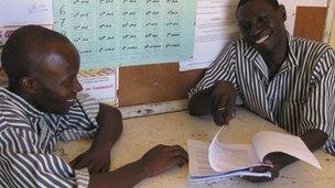 Kenyan prisoner Abdi Moka (L) and paralegal prisoner Douglas Owiyo (R)