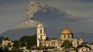 Ash spews from Popocatepetl volcano, as seen from San Damian Texoloc in Tlaxcala, on 9 July