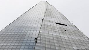 Greenpeace demonstrators climb the Shard building in central London