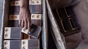 Wooden radio parts are seen ready to be assembled at a workshop in Temanggung, Central Java, Indonesia