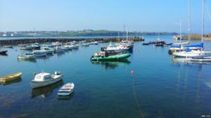 Boats moored in Portrush Harbour - by Ken Cox