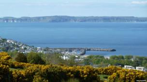 Ballycastle, taken from the slopes of Knocklayde Mountain - by Bob Huggins