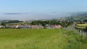 Mist settles over the town of Ballycastle - by Mervyn Robb