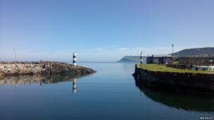 Clear blue skies over Carnlough Harbour - by Ben Malloy