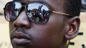 Protesters reflected in a Malian man's sunglasses, Gao, Mali - Friday 5 July 2013