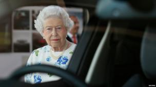 The Queen looks into a Range Rover