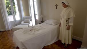 A nun in the room where Pope Francis will stay, 11 July 2013