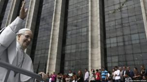 A statue of the Pope Francis is pictured in front of Rio de Janeiro city hall, 10 July