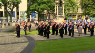 The parade stopped at Belfast's City Hall to allow Orangemen to lay a wreath at the Cenotaph.