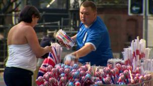 In the city centre, traders prepare for an influx of trade selling a range of red, white and blue products.