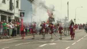 In Bangor, County Down, the North Irish Dragoons Society staged a re-enactment of the Battle of the Boyne, ahead of the main parade.