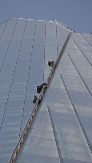 Greenpeace protesters climbing the Shard. Photo: Simon Taylor