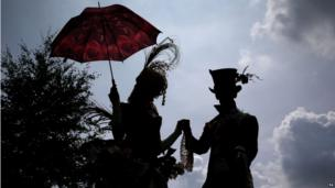 Stilt walkers on Darley July Cup Day at the Piper-Heidsieck July Festival at Newmarket Racecourse, Newmarket.