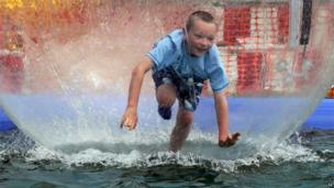 Joshua Prentice, aged eight from Belfast, inside a water ball at the Dalriada Festival at Glenarm Castle, Co. Antrim