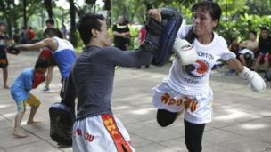 Woman takes part in martial arts class