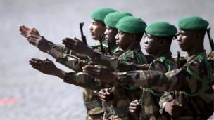 Malian troops march
