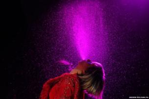 Karen O from the Yeah Yeah Yeahs sprays water