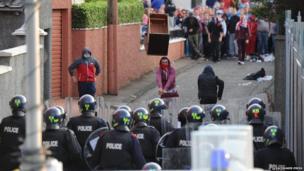 Furniture being thrown at police