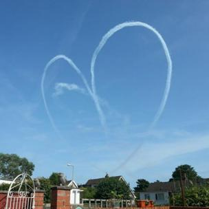 Heart-shaped vapour trail over Swansea