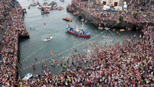 About 25,000 people attended the boat procession of the Virgen del Carmen, patron saint of fishermen, at Puerto de la Cruz on Tenerife