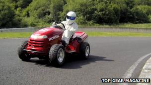 The Stig driving a lawn mower