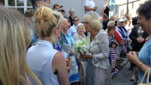 The Duchess of Cornwall receives birthday presents from the crowd