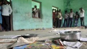 The scattered belongings of children who consumed a free midday meal in Dharma Sati village in the Saran district of Bihar state on 17 July 2013