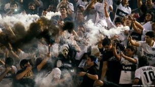 Fans of Paraguay's Olimpia celebrate a goal
