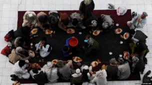 Afghan men break their fast during the holy month of Ramadan at the Hazrat-e Ali shrine in Mazar-i Sharif in northern of Afghanistan