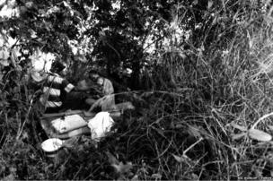 Hiding from the Thai police, and too afraid to return to Burma, a migrant family hides in the no-man's land of the border during the crackdown in November 1999