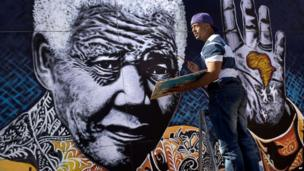 South African artist John Adams working on a painting of Nelson Mandela, Johannesburg, South Africa - Monday 15 July 2013