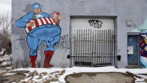 Graffiti showing Captain America covers an abandoned building in Detroit. File photo from February 2013
