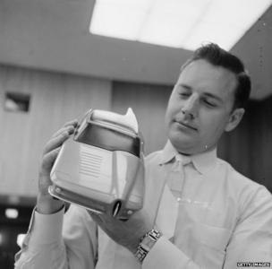 An employee at General Motors in Detroit shows a prototype of a car in 1955