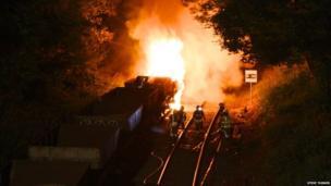 Cargo train carriage on fire. Photo: Steve Turner