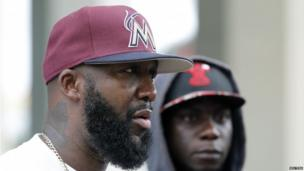 Tracy Martin, father of Trayvon Martin, stands next to his nephew Stephen Martin (r) during a rally for his son in Miami 20 July 2013