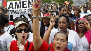 People attend a rally led by Tracy Martin, father of Trayvon Martin, in Miami 20 July 2013
