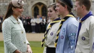 The Duchess of Cambridge, showing visible signs of pregnancy, meets scouts during the National Review of Queen's Scouts at Windsor Castle in Berkshire in April 2013