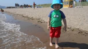Boy standing on a beach