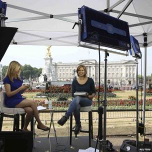 TV team outside Buckingham Palace