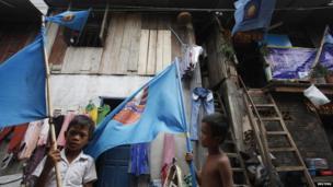Boys hold flags
