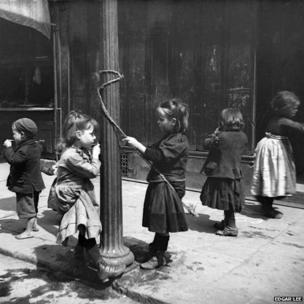 Children using street lamp for a swing, Edgar Lee, c 1892