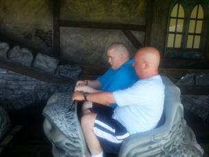 Mark Neary and Steven at a theme park