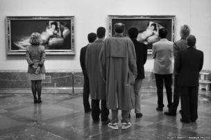 People look at paintings in the Prado Museum, Madrid, 1995