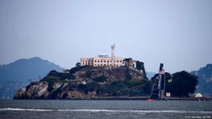 The Oracle Team USA AC72 catamaran sails near Alcatraz Island during a practice run at San Francisco Bay, California