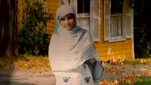 A young girl in a headscarf