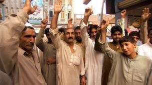 Men cheering in the street