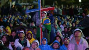 Faithful listen during welcoming ceremony