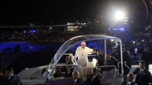 Pope in popemobile making his way through the crowds
